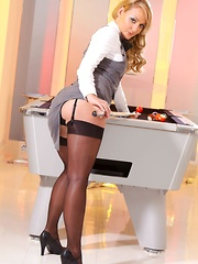 Pool hustler Sara wearing tight fitting skirt suit and black stockings