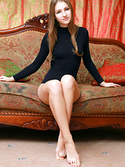 Izabel A poses so naturally on the elegant sofa showcasing her innocent and cute face, and youthful, delectable body.