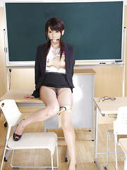 Teacher Maho Sawai shows her slit in class