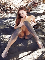 Latin girl outside in the mud, showing all her sexy petite body to the whole internet.