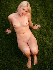 Shy white-haired girl relaxing on the backyard