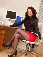 Hayley G posing in the office