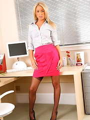 Lovely secretary removes pink miniskirt and shirt.
