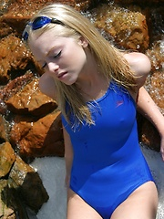 Blonde teen Skye shows off her tight little body at the pool in a tight one piece bathing suit