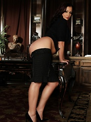 Beautiful busty brunette, Aria Giovanni, gets dressed up in her black shirt, skirt, heels with her long black hair up. She lets her hair down and stri
