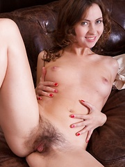 Vita strips naked and masturbates near her sofa