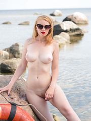 Helene poses outdoors as she strips her bikini baring her luscious, creamy body.