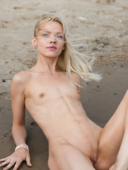 New model Camelia sensually strips at the beach as she bares her petite body.